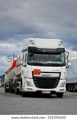 FORSSA, FINLAND - AUGUST 16, 2014: DAF CF Euro 6 tank truck parked. PACCAR reports record annual revenues of $18.99 billion and net income of $1.36 billion for 2014. - stock photo