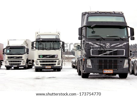 FORSSA, FINLAND - JANUARY 25, 2014: Group of Volvo trucks in winter conditions. Volvo Trucks has developed a system known as Stretch Brake that significantly improves safety for slippery winter roads. - stock photo