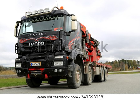 FORSSA, FINLAND - MAY 5, 2014: Iveco Trakker with Palfinger PK 85002 truck mounted crane. Launched in 1993, Iveco Trakker is a range of quarry and construction site vehicles.