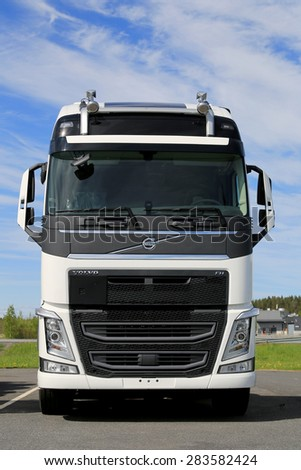 FORSSA, FINLAND - MAY 30, 2015: New, white Volvo FH truck parked. The large grille has been shaped in a particular way because the Euro 6 engines need more air. - stock photo