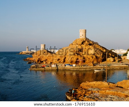 Fort and Lighthouse  in Sur in the Sultanate of Oman in the Middle East.  - stock photo