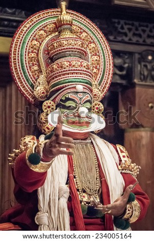 FORT COCHIN - FEBRUARY 16, 2013: Kathakali performer in the virtuous pachcha (green) role in Cochin on February 16, 2013 in Kerala, India. Kathakali is the ancient classical dance form of Kerala. - stock photo