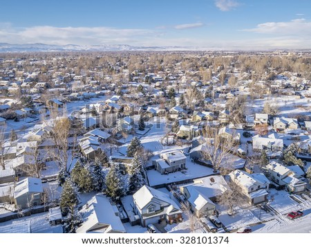 FORT COLLINS, CO, USA - December 28 2014: Aerial view of typical residential neighborhood along Front Range of Rocky Mountains in Colorado, winter scenery  - stock photo
