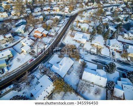 FORT COLLINS, CO, USA - NOVEMBER 29, 2015: Aerial  view of typical residential neighborhood along Front Range of Rocky Mountains in Colorado, late fall or winter scenery with snow. - stock photo