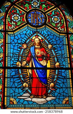 FORT-DE-FRANCE, MARTINIQUE: Stained glass window depicting Sacred Heart of Jesus in medieval church  - stock photo