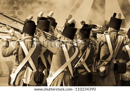 "FORT GEORGE, SCOTLAND- AUGUST 11 : Redcoat soldiers firing rifles during the annual ""Celebration of the Centuries"" event at Fort George, Scotland, August 11, 2012"