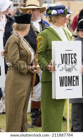 FORT GEORGE, SCOTLAND - AUGUST 9: Unidentified actor in the costume of a Suffragette activist at Fort George, Scotland, 9 August 2014 - stock photo