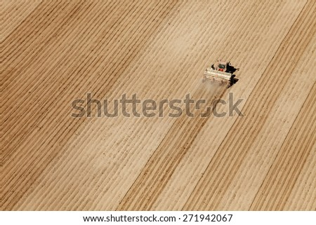 Fort Hall, Idaho, USA Apr. 17, 2015 An aerial view of farmers using tractors and planters to plant potatoes in the fertile farm fields of Idaho.