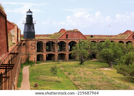 Fort Jefferson, a United States Army outpost built in the 19th century, features an inner courtyard and a lighthouse. - stock photo