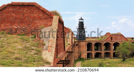 Fort Jefferson in Dry Tortugas National Park features a lighthouse and a vast courtyard. - stock photo