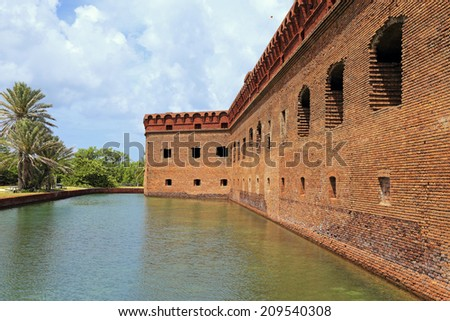 Fort Jefferson, surrounded by a moat of sea water, was built on Florida's Garden Key to protect United States shipping in the Gulf of Mexico. - stock photo