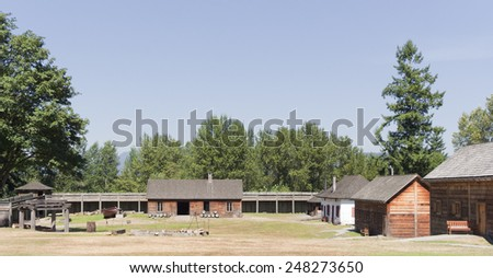 Fort Langley with Log Cabins and fortified Wall - Langley, British Columbia, Canada - stock photo