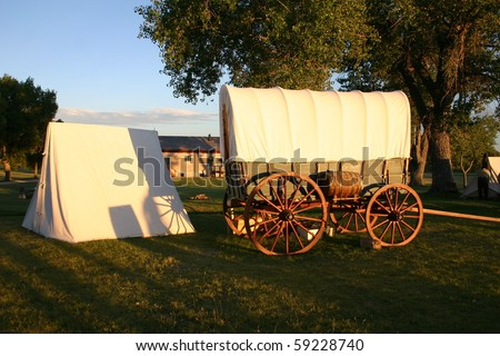 Fort Laramie National Historic Site  Wyoming covered wagons set up to depict a pioneer campsite - stock photo