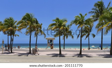 Fort Lauderdale beach near Las Olas Boulevard with the distinctive wall in the foreground. - stock photo