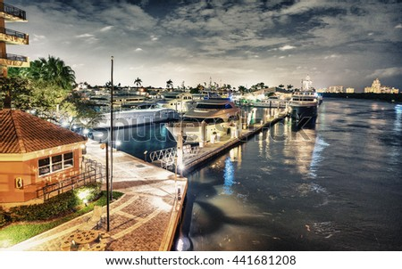 Fort Lauderdale by night along the canals. - stock photo