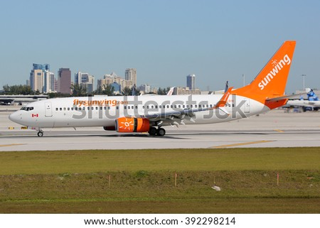 FORT LAUDERDALE, FL - FEBRUARY 17:  A Sunwing Airlines Boeing 737-800 landing on February 17, 2016 in Fort Lauderdale, FL. Sunwing Airlines is an airline from Canada headquartered in Toronto. - stock photo