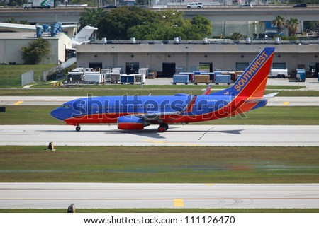 FORT LAUDERDALE, FL - MAY 10: A Southwest Boeing 737 taxis on May 10, 2012 in Fort Lauderdale, FL. Southwest is the world's second largest airline with 708 planes and 106.2 million passengers in 2010.