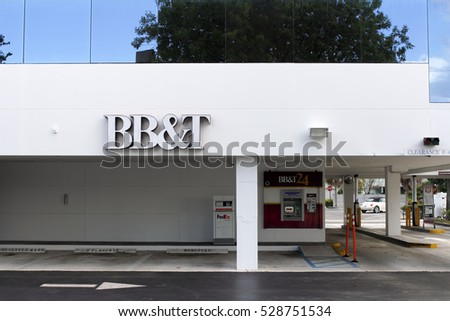 Fort Lauderdale, FL, USA - April 24, 2016: BB&T sign on bank building with ATM and drive through lanes. BB&T bank facade with  ATM and drive through banking signs
