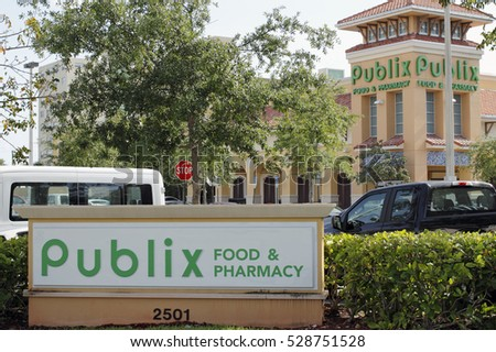 Fort Lauderdale, FL, USA - April 30, 2016: Two Publix Food & Pharmacy signs with a Publix grocery store. Publix grocery signs and supermarket on a sunny day
