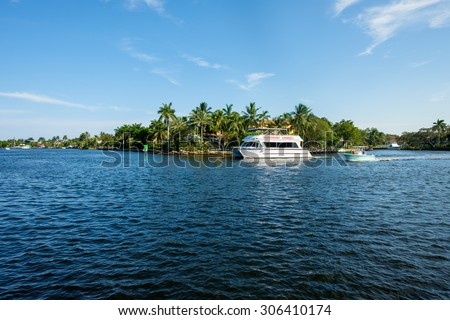 Fort Lauderdale, FL USA - August 12, 2015: Scenic view of the Fort Lauderdale Intracoastal Waterway along Las Olas Boulevard with visitors on a riverboat cruise. - stock photo