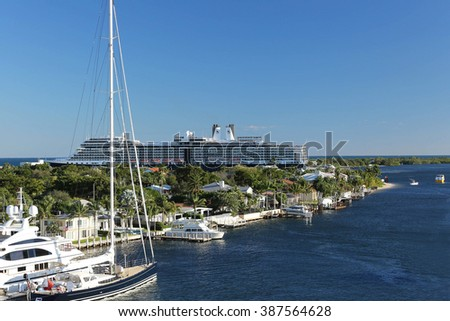 FORT LAUDERDALE, FL, USA-February 7, 2016:  MS Eurodam Signature cruise ship of the Holland America Line maneuvers the turning basin and exits Port Everglades close to private homes in Harbor Beach. - stock photo