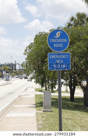 FORT-LAUDERDALE, FL, USA - JUNE 5, 2014: Blue and white evacuation route and emergency info 91.3FM signs with a symbol of a wave on top posted along Oakland Park Boulevard on a sunny day.  - stock photo