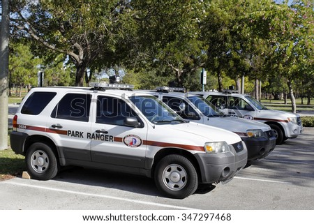 Fort Lauderdale, FL, USA - November 30, 2014: A few park ranger vehicles parked in the parking lot of Holiday Park. Three official park ranger vehicles parked on a sunny day.