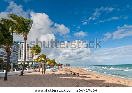 FORT LAUDERDALE, Fl, USA - NOVEMBER 27: View of Fort Lauderdale beach with people on autumn break vacations, enjoying the warm sunny weather on the sand and in the Atlantic ocean at November 27, 2011. - stock photo