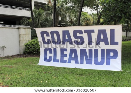 Fort Lauderdale, FL, USA - September 20, 2014: Coastal Cleanup sign with blue lettering and a white background. The sign is at the entrance to Earl Lifshey Ocean Park.