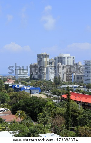 FORT LAUDERDALE, FLORIDA - APRIL 16, 2013:  Aerial view of many tall residential condominiums and other commercial and private dwellings along the Atlantic Ocean waterfront on a sunny spring day.