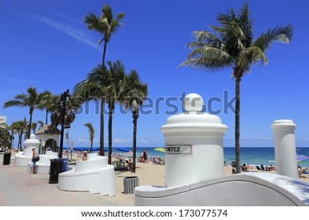 FORT LAUDERDALE, FLORIDA - APRIL 8, 2013: Many people relaxing, suntanning enjoying spring break at the popular tropical public beach on a warm and sunny day near Cortez Street and State Road A1A.  - stock photo