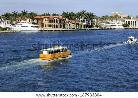 FORT LAUDERDALE, FLORIDA - FEBRUARY 3: On a sunny day an attraction and transportation called Water Taxi takes people for tours on the Intracoastal waterway February 3, 2013 in Ft Lauderdale, Florida  - stock photo