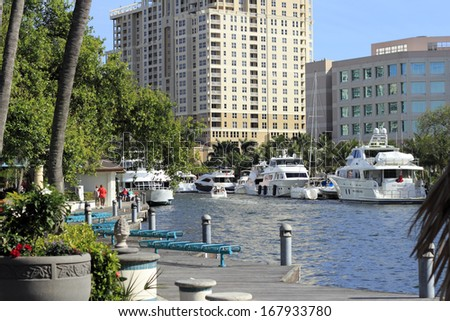 FORT LAUDERDALE, FLORIDA - FEBRUARY 3: People enjoying the Riverwalk Linear Park walkway and river with boats and beautiful views on a sunny day in downtown February 3, 2013 in Ft Lauderdale, Florida - stock photo