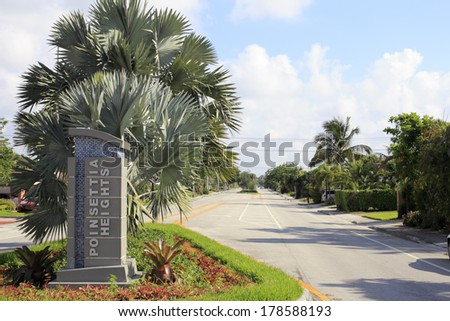 FORT LAUDERDALE, FLORIDA - JUNE 16, 2013: Modern entrance sign at an entry into an upscale community in north east Ft Lauderdale on a sunny morning.
