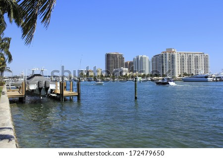 FORT LAUDERDALE, FLORIDA - MARCH 30, 2013: People with small boats cruising on the beautiful Atlantic Intracoastal waterway south of Las Olas Boulevard bridge on a sunny day in winter.  - stock photo