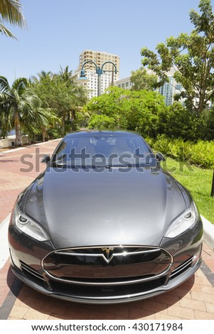 FORT LAUDERDALE - MARCH 30: Stock photo of a new Tesla P90D which is an electric vehicle capable of a 280 mile driving range on a single charge March 30, 2016 in Fort Lauderdale FL - stock photo