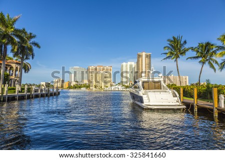 FORT LAUDERDALE, USA - AUG 20, 2014:  Boats at waterfront homes in Fort Lauderdale. There are 165 miles of waterways within the city limits. - stock photo