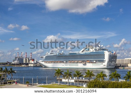 FORT LAUDERDALE, USA - AUG 1, 2010: Cruiseship Emerald Princess on pier on in Fort Lauderdale, USA. With 900 balcony staterooms it is one of the largest cruise ships in the world. - stock photo