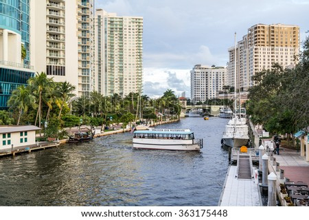 FORT LAUDERDALE, USA - DEC 6, 2015: Water taxi cruising on New River in downtown Fort Lauderdale, Florida, USA - stock photo