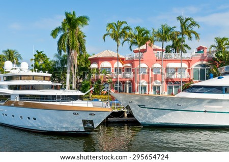 FORT LAUDERDALE, USA - DECEMBER 8: Luxury mansion and boats at waterfront homes in Fort Lauderdale at December 8, 2011.  - stock photo