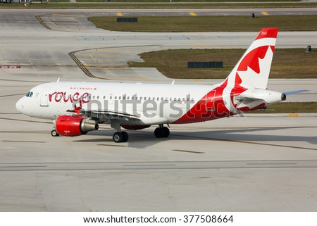 FORT LAUDERDALE, USA - FEBRUARY 15, 2016: Photo of an Air Canada Rouge jet Airbus taxiing the runwat at the Fort Lauderdale/Hollywood International Airport. - stock photo