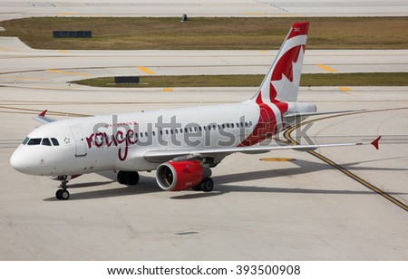 FORT LAUDERDALE, USA - February 25, 2016: Photo of an Air Canada Rouge jet Airbus taxiing the runwat at the Fort Lauderdale/Hollywood International Airport. - stock photo