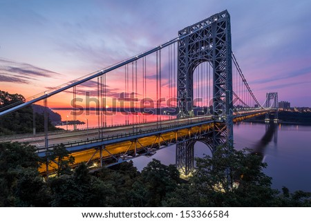 FORT LEE, NJ - JUNE 30: George Washington Bridge at sunrise on June 30, 2012 in Fort Lee, NJ. George Washington Bridge  is a suspension bridge spanning the Hudson River connecting NJ to Manhattan, NY. - stock photo