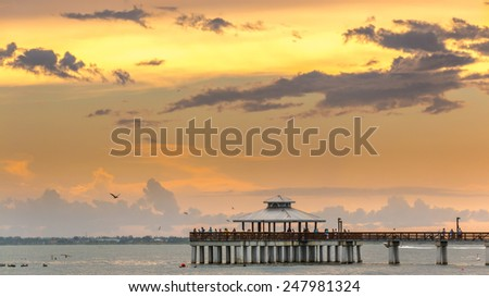 Fort Myers, Florida - Sept 1: People anxiously wait to see the beautiful sun set over the Atlantic Ocean at Fort Myers Beach, Florida, September 1, 2014 - stock photo
