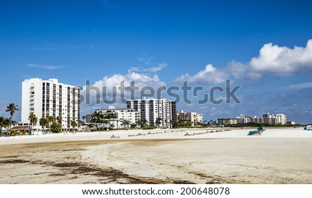 FORT MYERS, USA - JULY 27, 2013: Unknown people on a beach in Fort Myers, USA. Fort Myers first became a nationally known winter resort with the building of the Royal Palm Hotel in 1898.