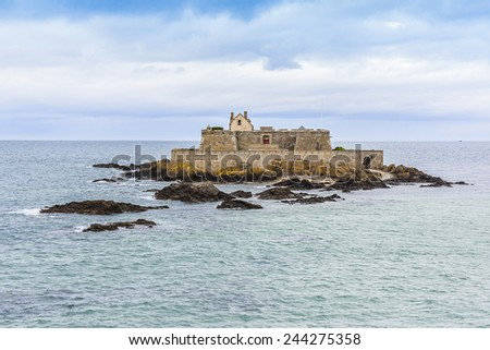 Fort National at sunset. Fortress located on tidal island Petit Be in Saint-Malo. Fort was built in 17th century to protect city. Saint-Malo is a walled port city in Brittany, France, English Channel.