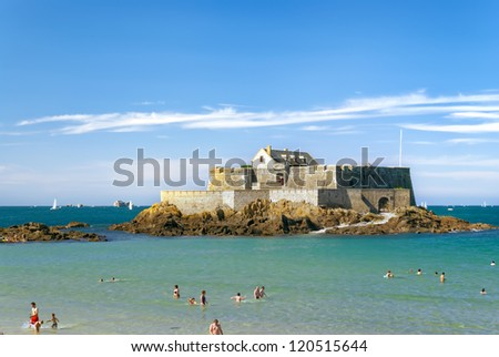 Fort National in Saint-Malo during high tide on a sunny day - stock photo