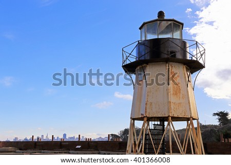 Fort Point Lighthouse adjacent to the Golden Gate Bridge in San Francisco, California. - stock photo