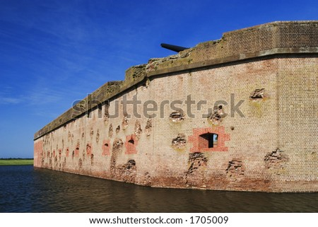 Fort Pulaski National Monument built 1829 to 1847 wall craters made by Union artillery, moat surrounds fort - stock photo
