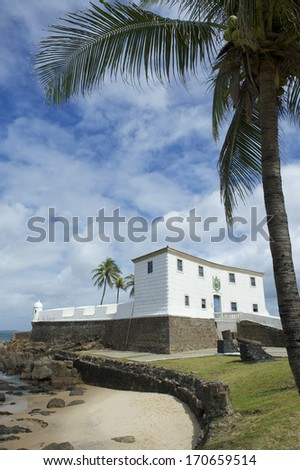 Fort Santa Maria in Barra Salvador Brazil features tropical beach and palm tree